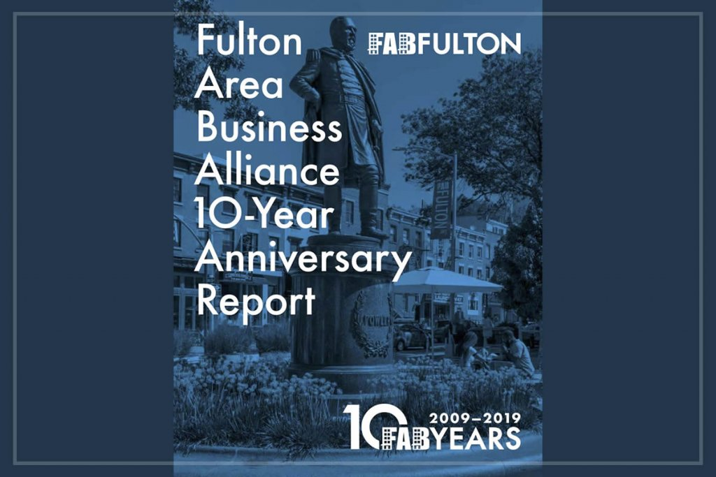 A graphic cover of the Fulton Area Business Alliance 10-Year Anniversary Report with blue filter over image of statue in Fowler Plaza with Fulton Avenue streetscape in the background.