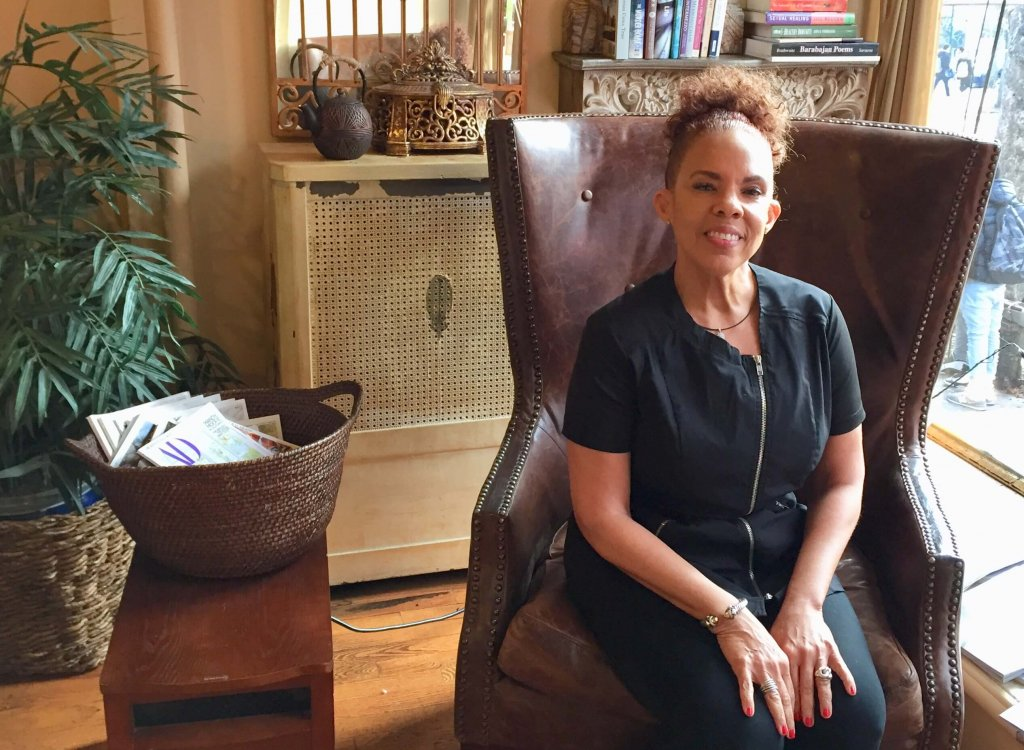 Owner of Cynergy Spa Marsha-Ann Boyea sitting in chair in her spa