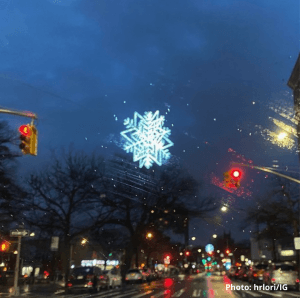 Fulton Street holiday lights snowflake at night